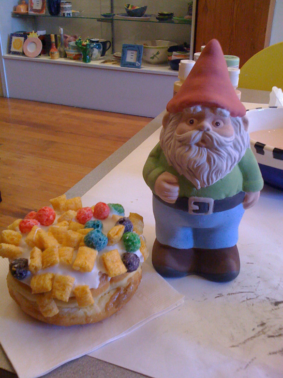 On the left is the donut from Voodoo Donuts I had after finishing painting my gnome, on the right :)  He is to be glazed and ready for pickup next week!