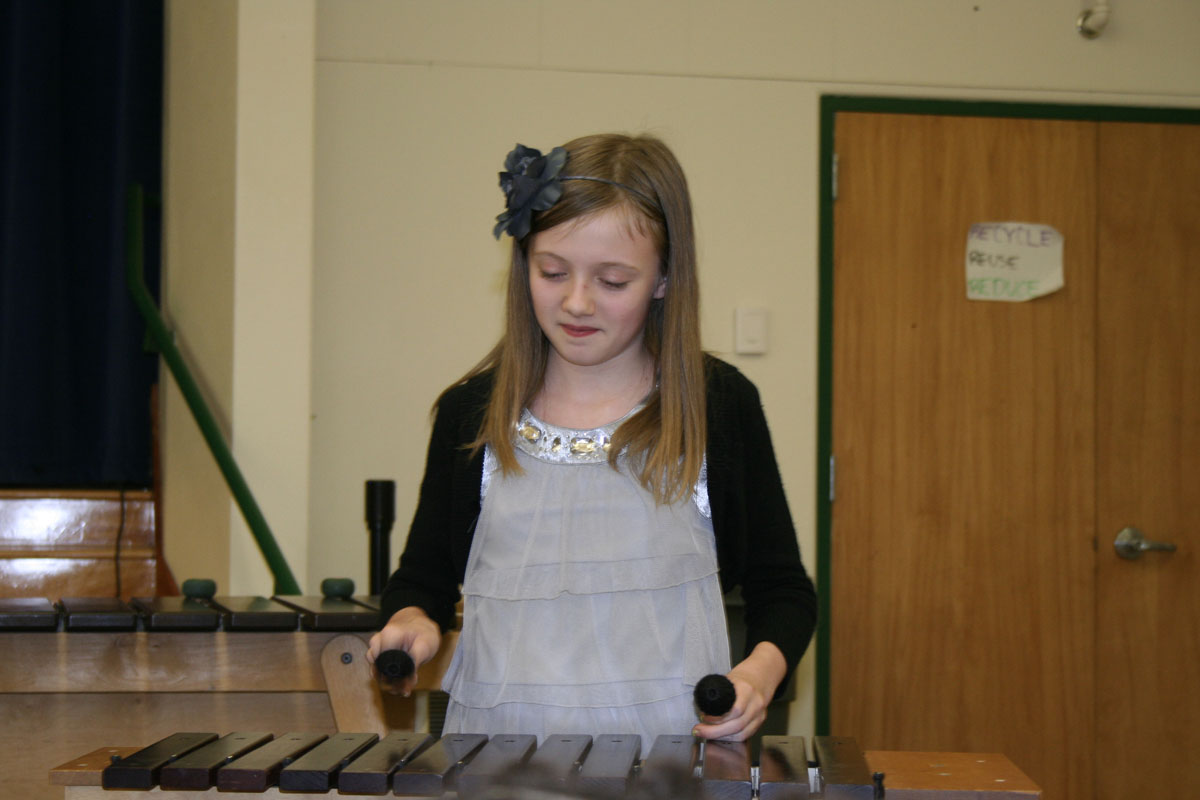 ...and on the xylophone, pretending not to notice I am taking her picture...