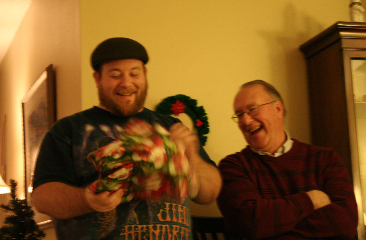 cousin George and Dad Bill get a kick out of that wrapping paper, I guess...