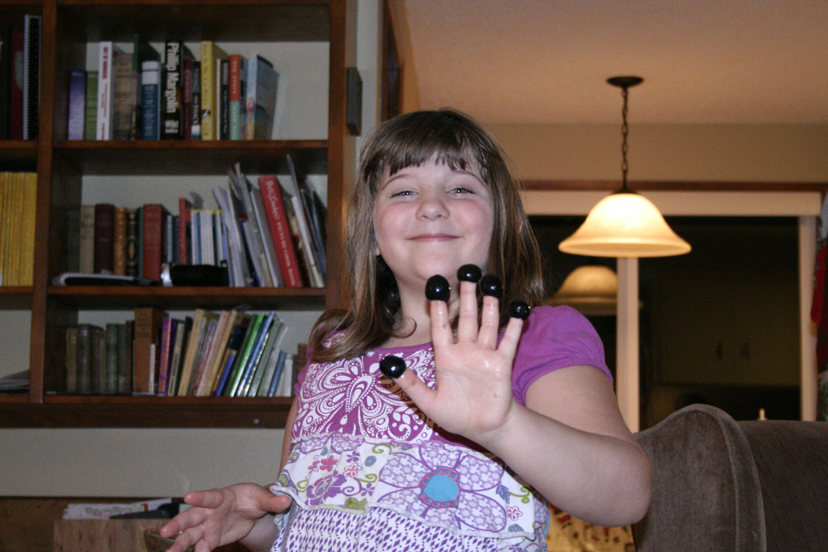 Gracie with olive fingers, who wouldn't love olives on their fingers?