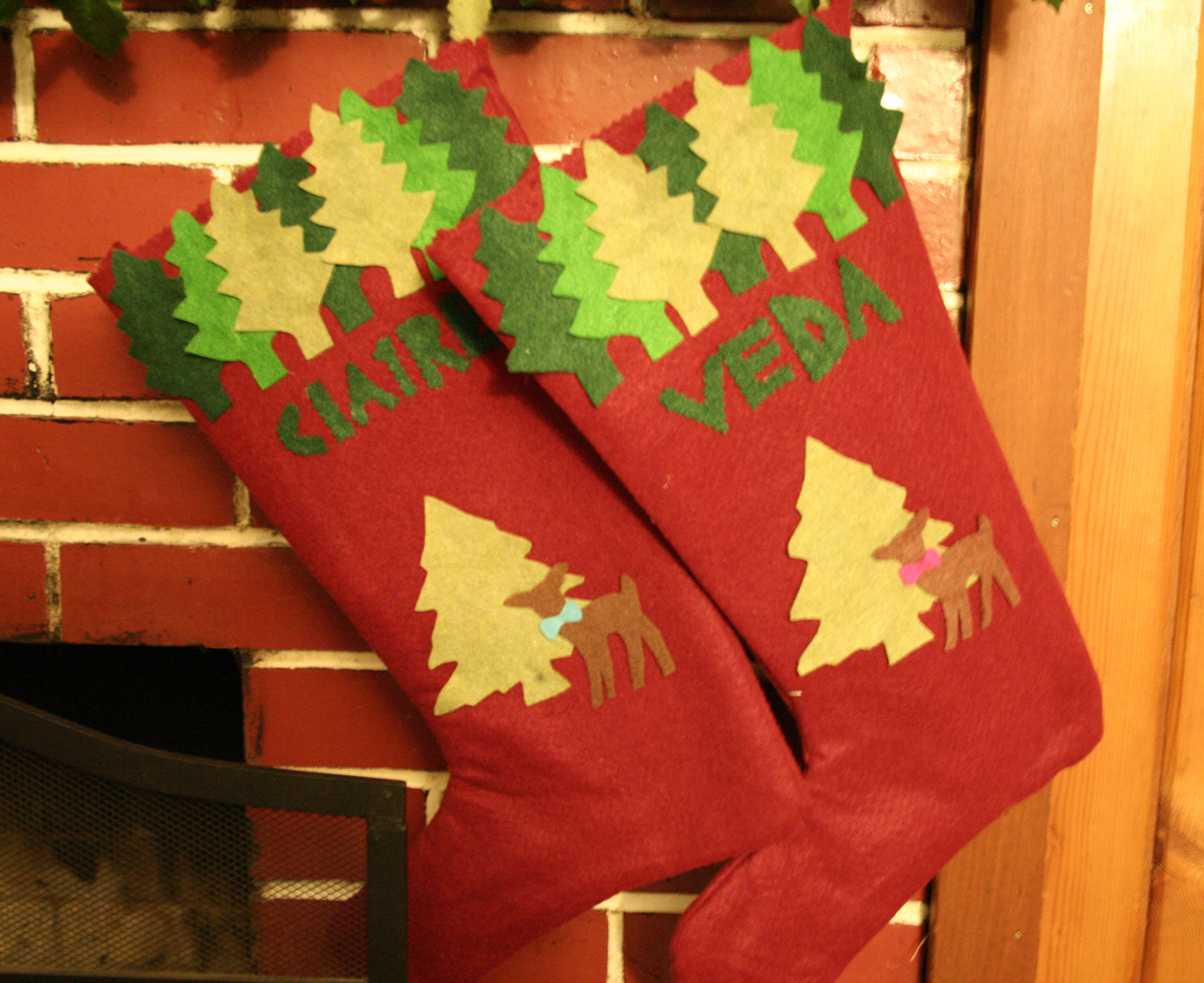 Here are the girls' stockings that I made that same craft-filled year - I need to make the dogs each one, that's also on the to-do list (it's a pretty long list)...