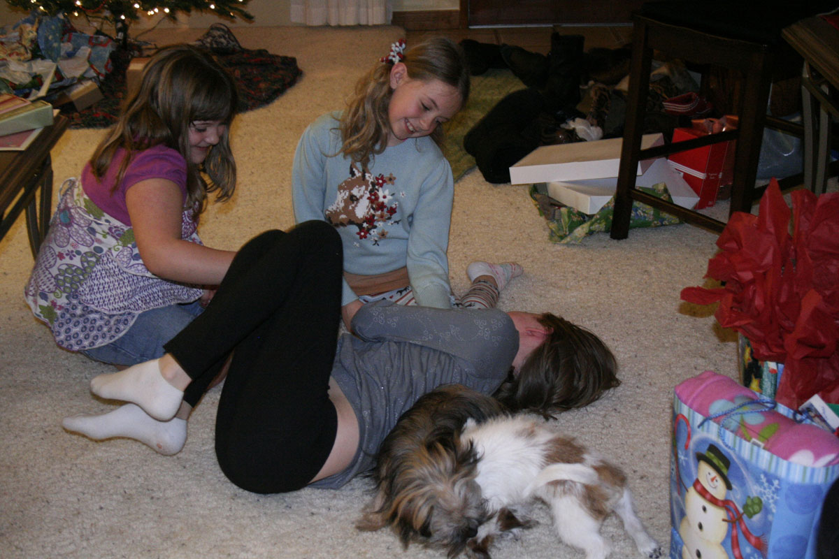 the dogs even talked the girls into joining in the wrestling fun..