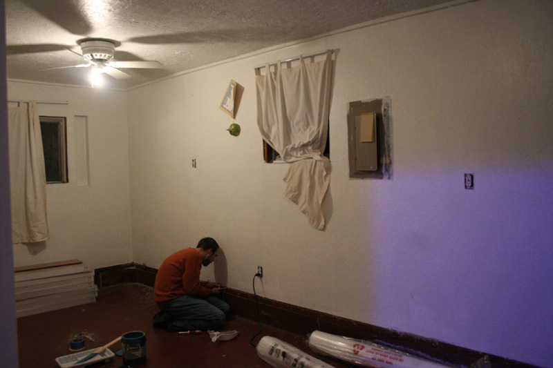 Here is Mark tearing away the leftover bits of carpet, which earned him a few blisters on his poor hands..
