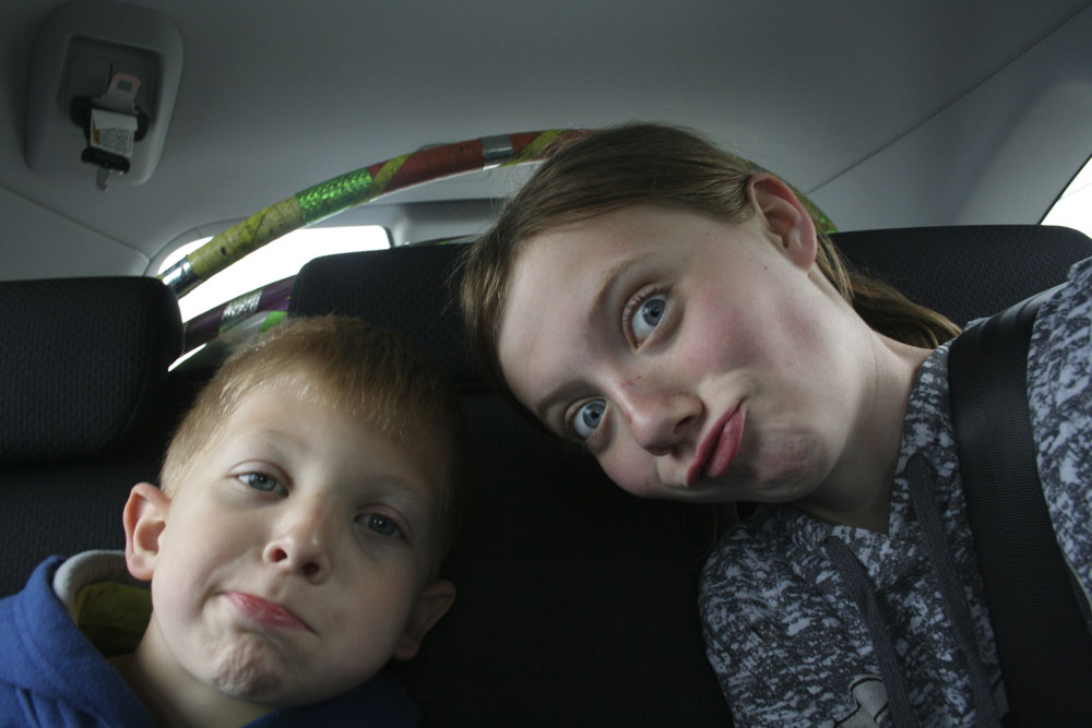 Claire and Wyatt, self portrait in the car on the way to look for seashells...
