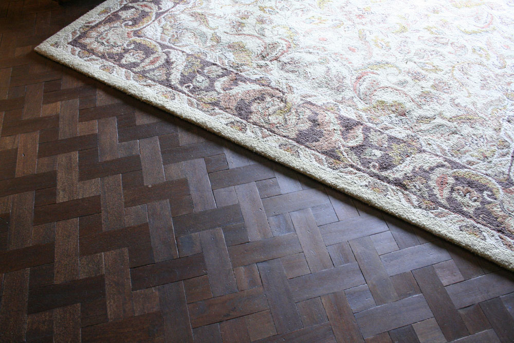 The pattern on the wood floors is beautiful, I wish we could this to our floors at home!